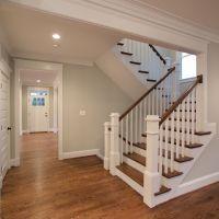 The beautiful U-shaped stair has hardwood treads and ...