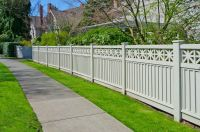 vinyl fence along sidewalk