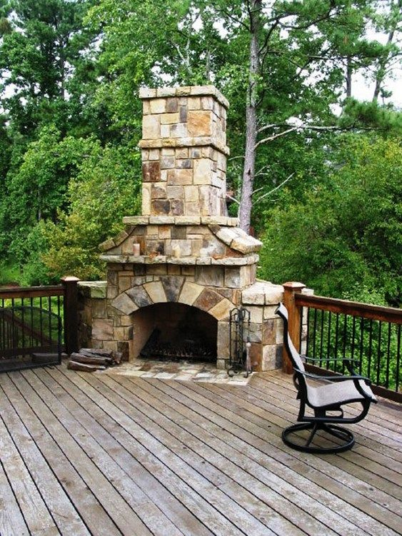 Stone stacked massive corner fireplace on wooden deck