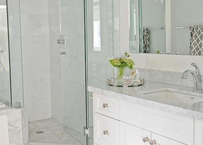 Light grey floor tiles white vanity quartz countertop also going for this look