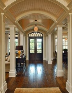 Love the doors entry space floors columns as entrances to rooms and hallway they create  imagine that it leads kitchen  dining room has also from ceiling arches those all works so rh pinterest