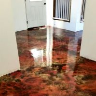 Painted concrete floor. I took black concrete paint and
