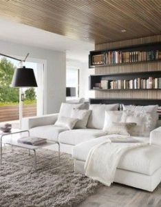 Wonderful modern apartment for book lovers standing lamp in what is living room ideas design with ceiling lighting and white wall also wohnzimmer pinterest spanish interior rh