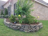 Stacked my own stone flowerbed border in a couple of hours ...