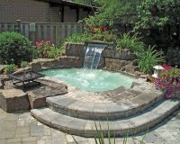 Inground Hot Tub With Waterfall And Fire Pit