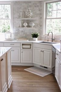 White Quartz countertops and the backsplash is Carrera