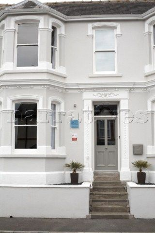 Painted House Exterior With Bay Windows And Steps To Front Door