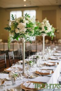Tall elegant table centerpieces that have white flowers ...