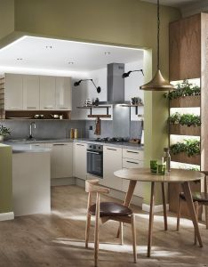 light warm and inviting kitchen with high gloss cabinet this has stylish modern feel take look at howdens for more ideas also houseplants are perfect addition to our glendevon cashmere rh pinterest