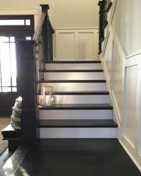 Modern farmhouse painted and stained stairs with brass ...