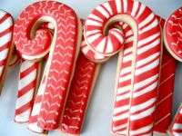 Candy cane decorated sugar cookie. Royal icing. Red, white ...