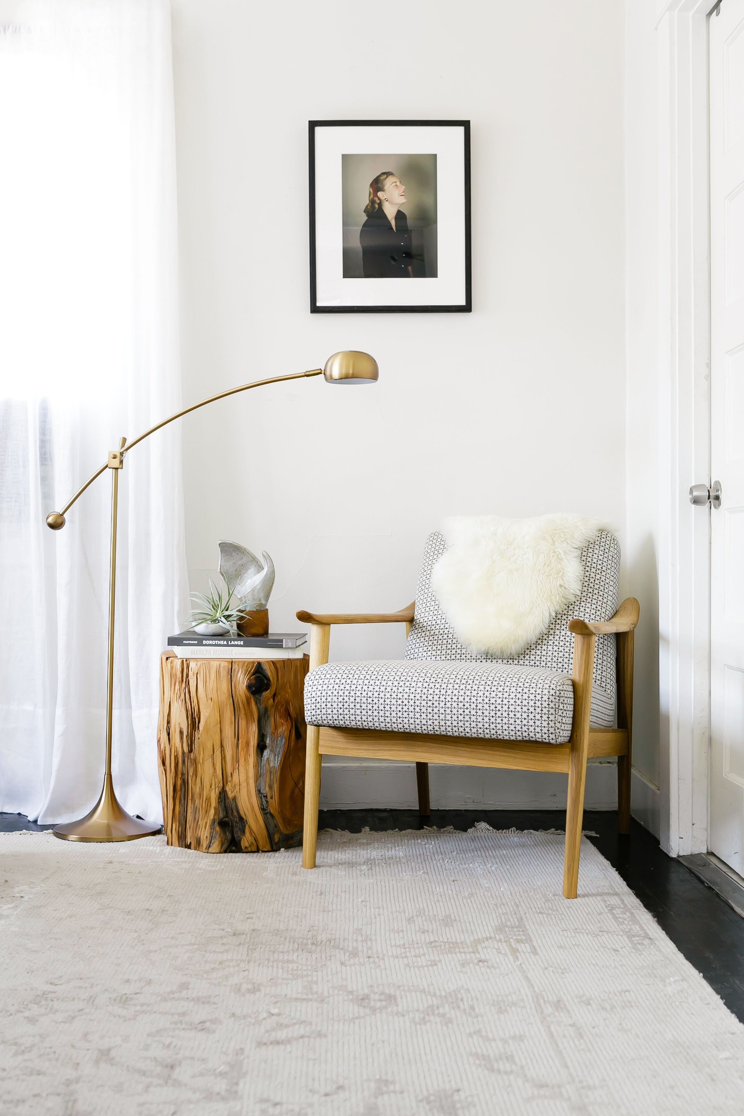 reading nook chair couch arm covers warm modern with brass lamp and midcentury