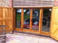 Exterior. brown teak wood frame sliding patio glass door ...