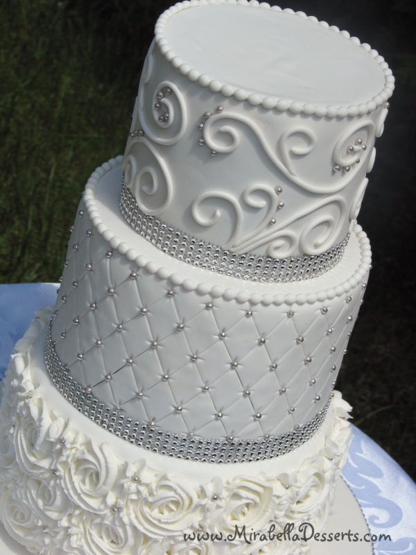 3 Tier White Wedding Cake Decorated With Buttercream