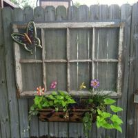 Old window we hung on the privacy fence with a window box ...