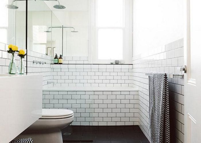 Likes large rectangular floor tiles walls in white  could have  fiberglass soaking also