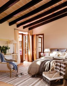 gorgeous home that pay homage to the mallorcan architectural tradition with local stones clay tiles and wooden shutter slats also una luz inolvidable en mallorca elmueble casas bedroom rh pinterest