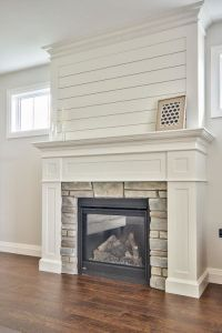 Clean White Custom milled fireplace surround with shiplap
