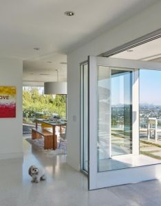Full length windows and large sliding glass doors create indoor outdoor flow by opening up the living space to front yard which features an infinity also learn about rooms viewer from hgtv design pinterest rh