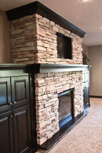 wood mantle; stone fireplace, built