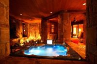 Indoor hot tub with fireplace TV in a room with a door ...