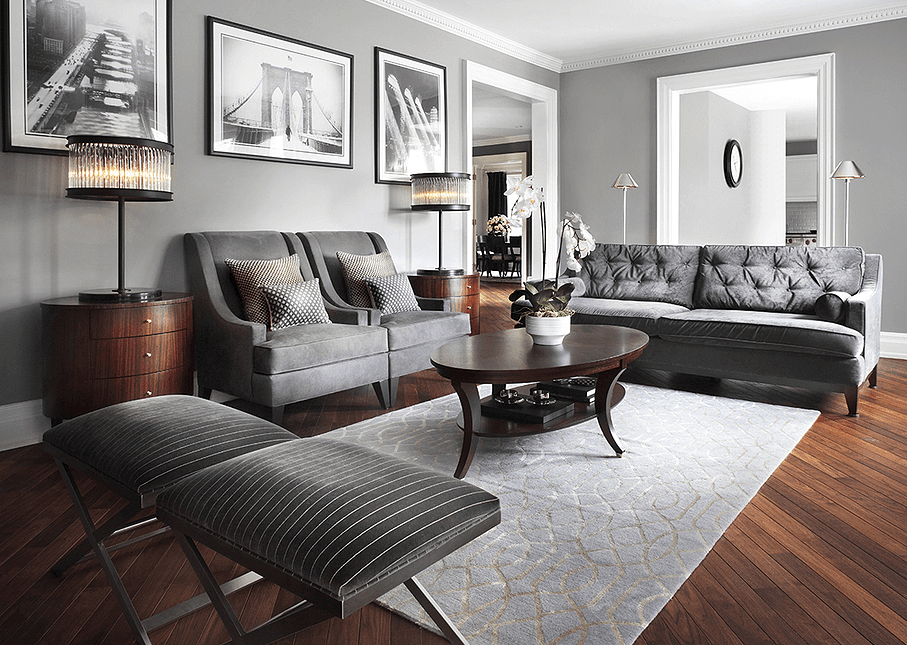 Gray living room. Charcoal tufted sofa and 2 armchairs