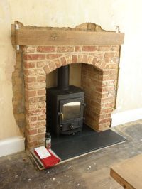 Pioneer 400 woodstove with brick arch fireplace | brick ...
