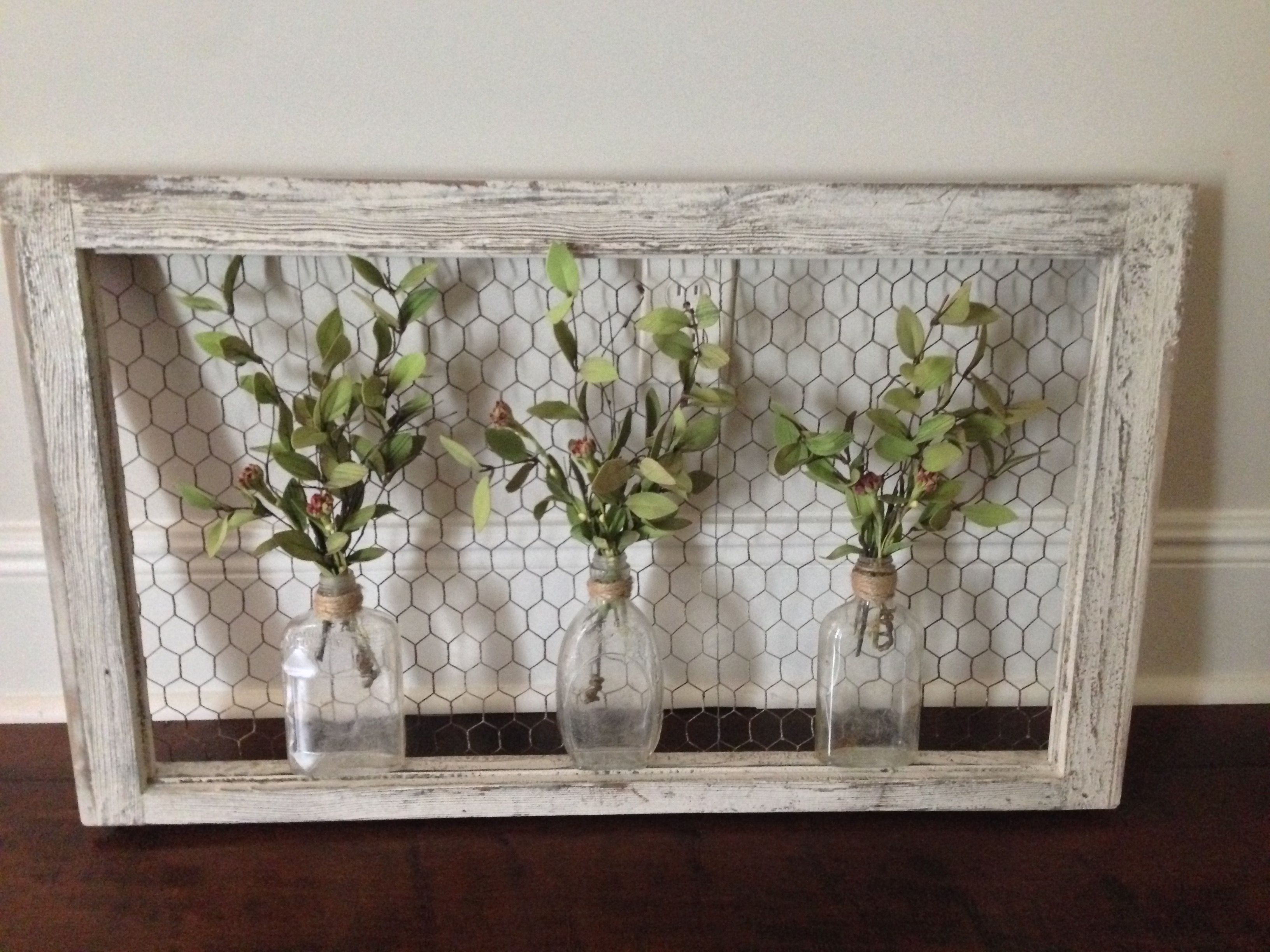 Wall art: old window frame, chicken wire, old bottles and