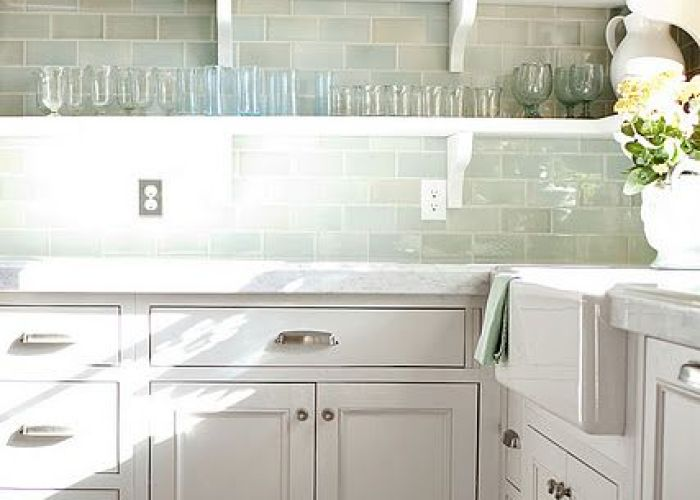 Love the watery green subway tile backsplash pair with soft white cabinets also