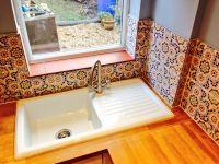 Handmade Mexican tile splashbacks fitted. Including ...