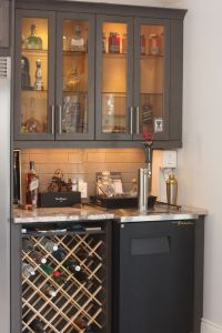 Custom wine rack in bar area with Kegerator and glass door