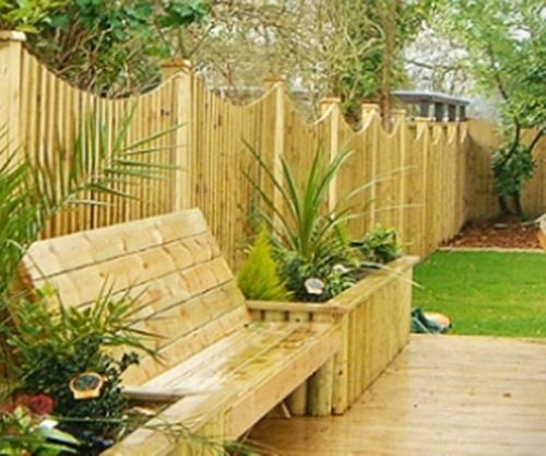 Home Garden Fencing With Bench And Raised Flower Bed Outside