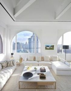 Skyhouse by ghislaine vinas interior design cool open space with high beam ceilings  big arch windows city view the all white scheme plush also dekorasyonda beyaz renginin kullan  na guzel bir ornek living rh pinterest