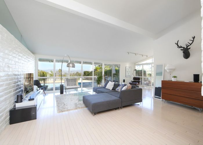 If you crave bright light filled spaces this midcentury home for sale could be the one also