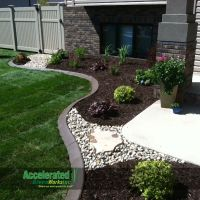 River rock and flagstone step stone allow access through ...