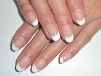 Rounded French tips with silver glitter bands from Yucca ...