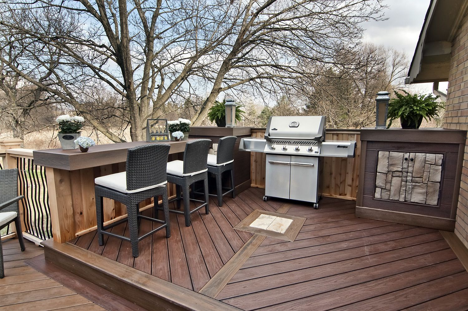 A Barbeque Nook With Side Tables & A Built In Cabinet, And
