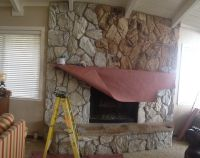 """Change your old 70's fireplace with paint. Keep the """"Rock ..."""