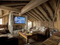 A very warm and cozy post and beam living room ...