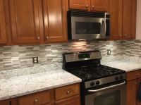 Done installing backsplash over new countertops. Gray