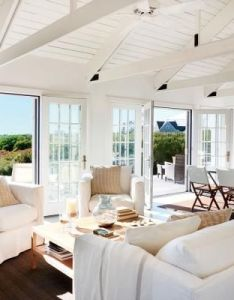 To make this small home feel larger and the ceilings seem higher designer stephen theroux brightened walls ceiling beams trusses with li  also rh pinterest