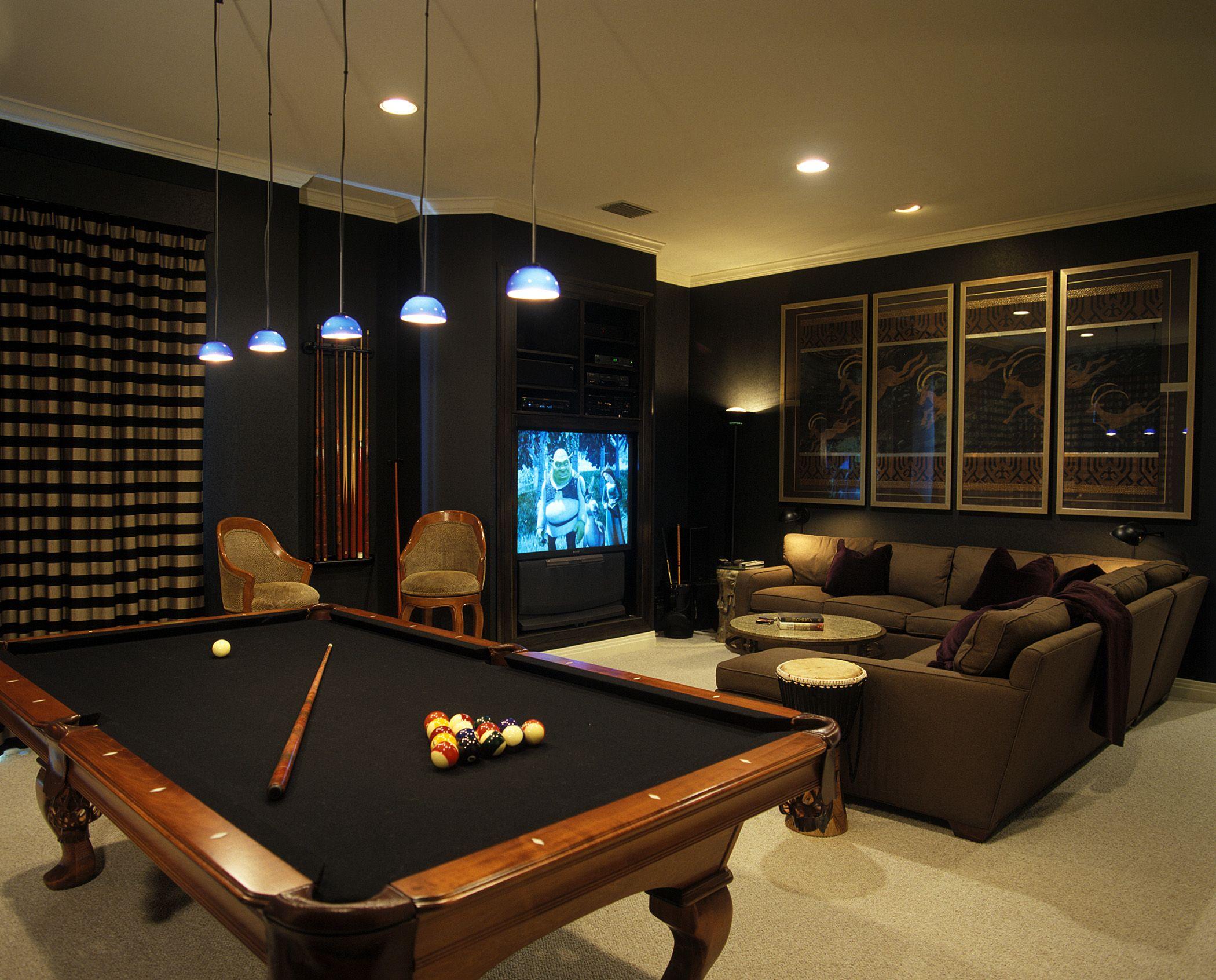 Dark media room with pool table