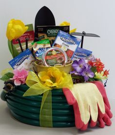 This 60' Garden Hose Basket Is Filled With Gardening Goodies Both