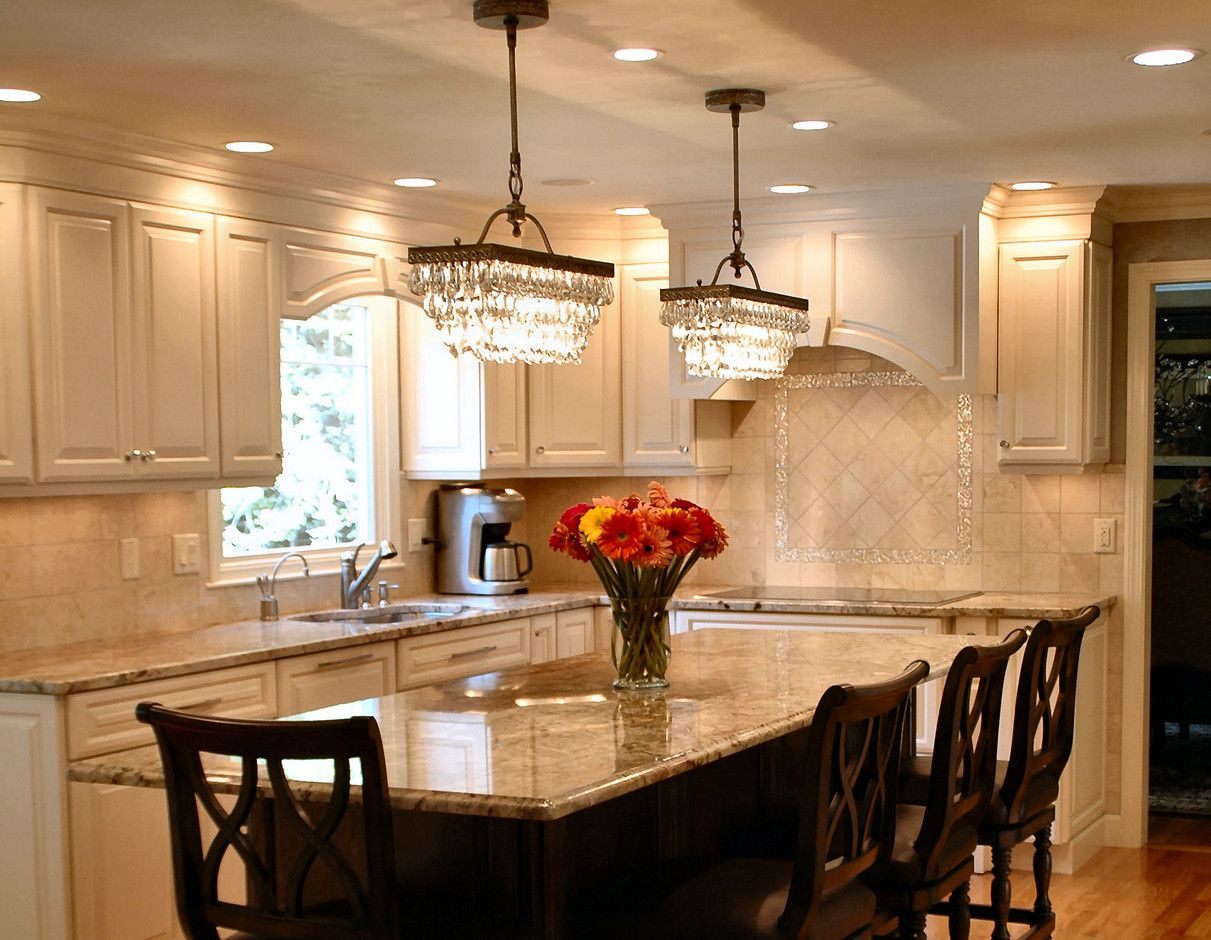 two chandeliers over dining table  Recipes to Cook