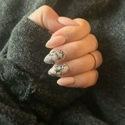 marble and nude almond shaped nails