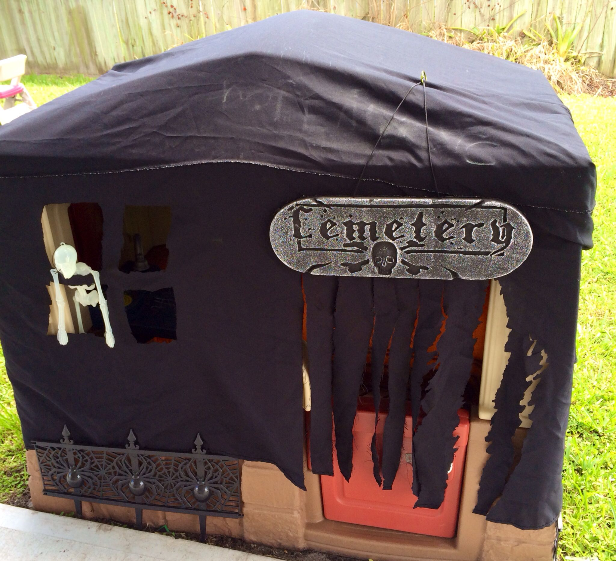 Turn A Kids Outdoor Playhouse Into A Haunted House Using A Black