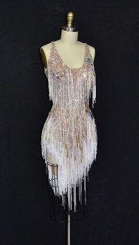 Short, white latin dress with heavy stoning, fringe, and ...