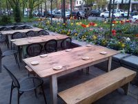 Nice spring flowers and tulips around an outside patio at ...