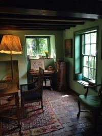 Old English cottage with brick floor. The sitting room at ...