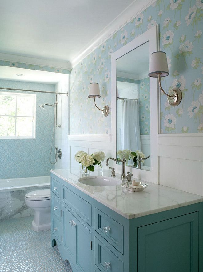 This bathroom features custom designed vanity in blue